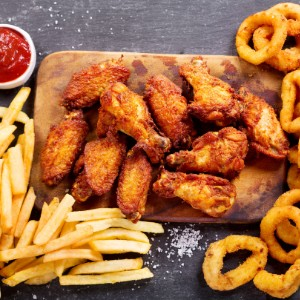 Wings, fries, and onion rings.